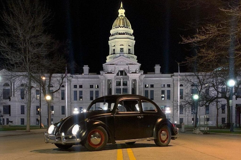 1964 VW Bug in front of Wyoming state capital