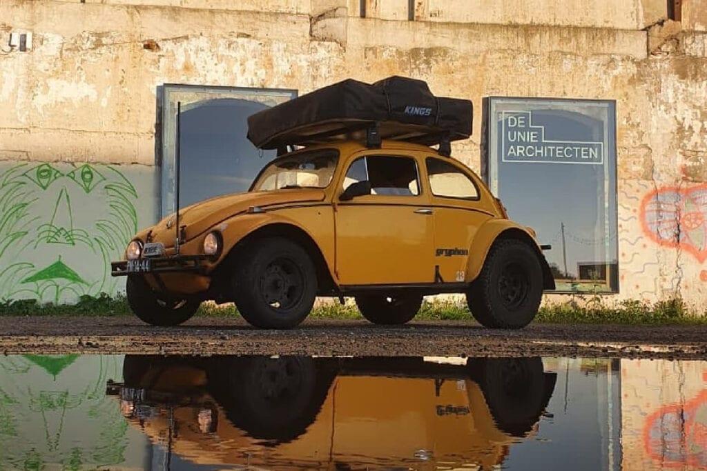 1964 Overland Baja Bug outside near large puddle